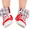 Girl legs in sport shoes — Stock Photo