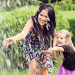 Stock Photo: Happy mother and daughter in park