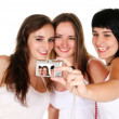 Three beautiful girls taking a photo — Stockfoto