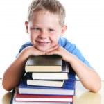 Happy child with books — Stock Photo