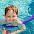 Child learning to swim — Stock Photo #19395231