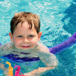 Child learning to swim - Stock Photo