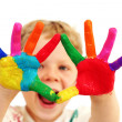 Happy child with painted hands — Stock Photo #19395243