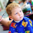 Stockfoto: Child at hairdresser