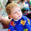 Child at the hairdresser - Foto Stock