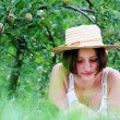 Readind under apple tree — Stock Photo