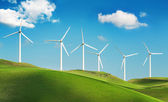 Wind turbines on green hills — Stock Photo