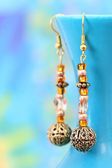 Beautiful handcrafted earrings — Stock Photo