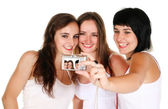 Three beautiful girls taking a photo — Stock Photo
