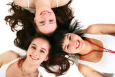 Three beautiful girls on the floor — Stock Photo