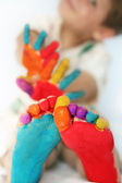 Happy child with painted feet and hands — Stock Photo