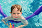 Child learning to swim — Stock Photo