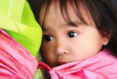 Little girl in a sling — Stock Photo