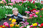 Child in flowers — Stock Photo