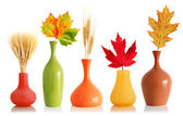Colorful leaves and wheat in vases — Stock Photo