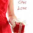 Red gift box in woman's hands — Stock Photo