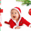 Christmas baby unders a tree with gifts — Stock Photo