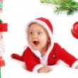 Christmas baby unders a tree with gifts — Stock Photo #30942735