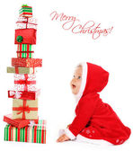 Christmas baby with gifts — Stock Photo