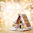 Christmas gingerbread house decoration on defocused lights backg — Stock Photo