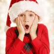 Surprised Christmas boy — Stock Photo