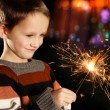 Boy with sparkler — Stockfoto
