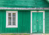 Detail of a traditional green wooden house in Trakai — Stock Photo