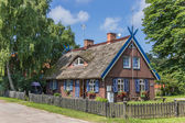 Traditional wooden house on Curonian Spit — Stock Photo