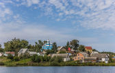 Small Ukrainian village with a blue church — Stock Photo
