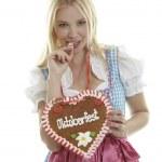 Woman with German Lebkuchen heart — Stock Photo