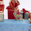 Christmas gifts with reindeer - Stock Photo