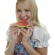 Woman in Dirndl eats Watermelon — Stock fotografie