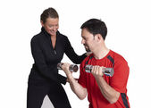 Weight lifting with fitness coach — Stock Photo