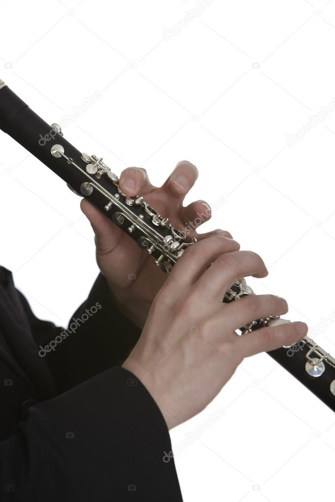 Clarinet player in front of white background  Stock Photo #19259249