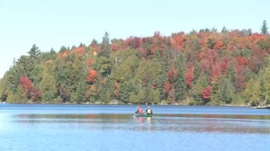 ALGONQUIN PARK, CANADA, SEP 24, 2009: boating with a canoe on a lake in a peacefull nature scene