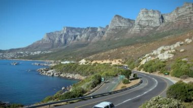 12 APOSTLES, SOUTH AFRICA - MARCH 18: in this time-lapse view cars drive in front of 12 Apostles on March 18, 2010 in Cape Town, South Africa.