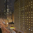 Traffic at night on 8th Avenue - Stock Photo