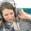 Woman listening to music — Stok video