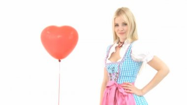Woman in Dirndl with heart shaped balloon — Stock Video