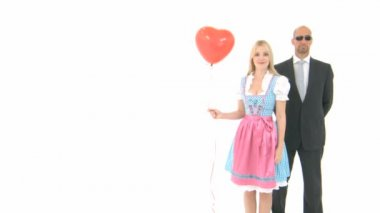 Woman in Dirndl with Bodyguard — Stock Video