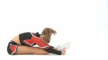 Cheerleader stretches — Stock Video