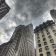 Dark Clouds above Skyscraper - Stock Photo