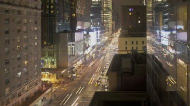 NEW YORK CITY  - Feb 11: Timelapse of Traffic and reflection at night passing by on 8th Avenue on February 11, 2012 in New York City, USA