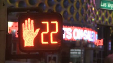 LAS VEGAS - MAR 1: Red Pedestrian Traffic Light counts down from 27 to 0 with advertising in the background on March 1, 2012 in Las Vegas, USA