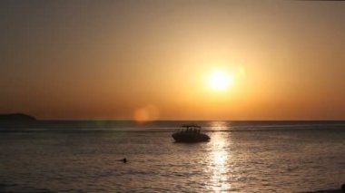 Ibiza Sunset at the sea with boats on the water — 图库视频影像