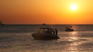 Ibiza Sunset at the sea with boats on the water — Stock video