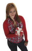 Woman smiling at a present — Stock Photo