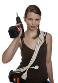 Craftswoman with a power drill — Stock Photo