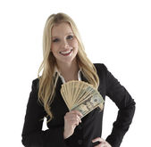 Woman with currency — Stock Photo