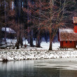 Winter landscape with little house ,forest,and lake. Wide 16:9 photo — Stock Photo